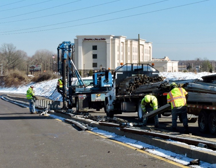 Crews removing the guiderail on U.S. 1
