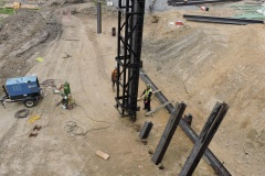 August 2021 - A pile driver is set up to drive another I-beam pile to support the embankment for construction of the northern abutment of the new bridge over Neshaminy Creek.
